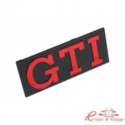 Logotipo de GTI rojo sobre fondo negro